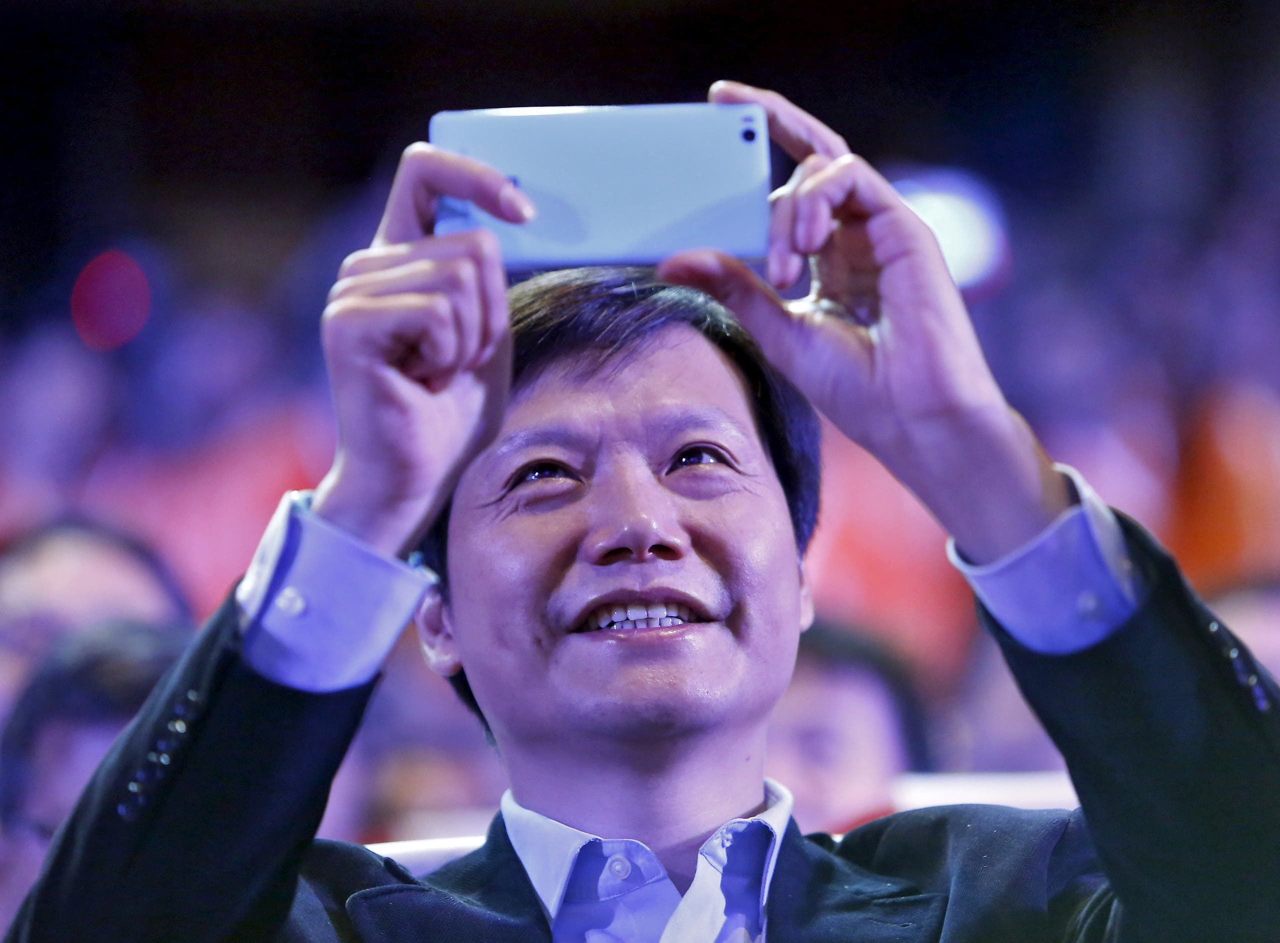 Lei Jun, founder and chief executive officer of Xiaomi, uses a Mi 4i phone during its launch in New Delhi , India. (File photo: Reuters)