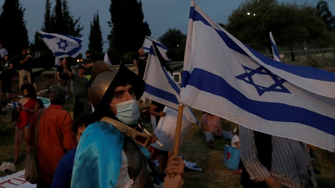 A protester waves a flag during a demonstration against Israeli Prime Minister Benjamin Netanyahu's new unity government with rival Benny Gantz, outside the Knesset, Israel's parliament, in Jerusalem May 14, 2020. (Reuters)