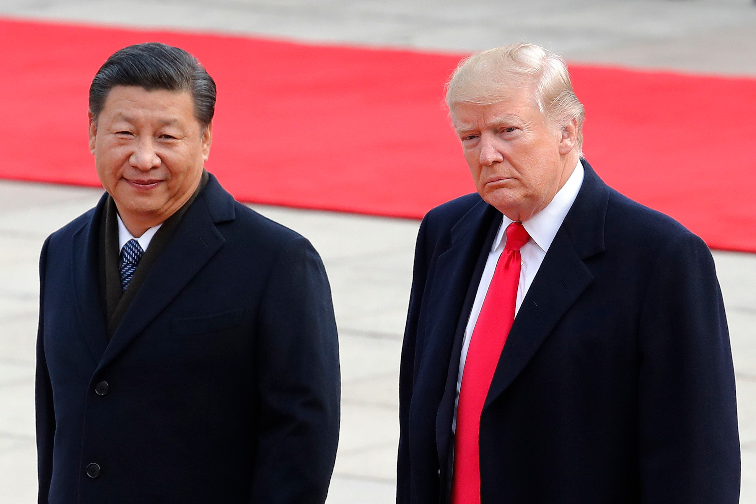 US President Donald Trump, right, walks with Chinese President Xi Jinping in Beijing on Nov. 9, 2017. (AP)