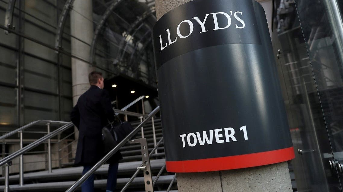 A worker enters the Lloyd's of London building in the City of London financial district, London, Britain. (Reuters)