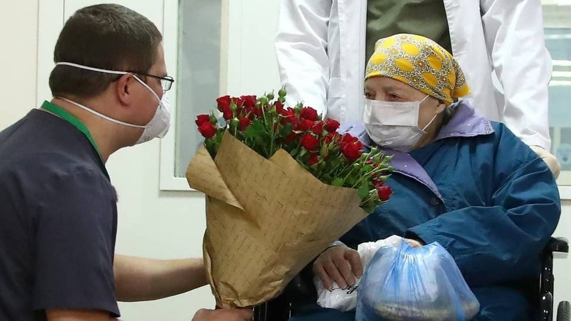 Pelageya Poyarkova, 100, wearing a protective mask poses for a picture as she leaves the hospital. (Twitter/@mfa_russia)