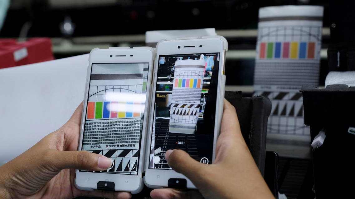 A worker conducts a color test on OPPO F1s smartphones at an OPPO smartphone factory in Tangerang, Indonesia, September 20, 2016. REUTERS