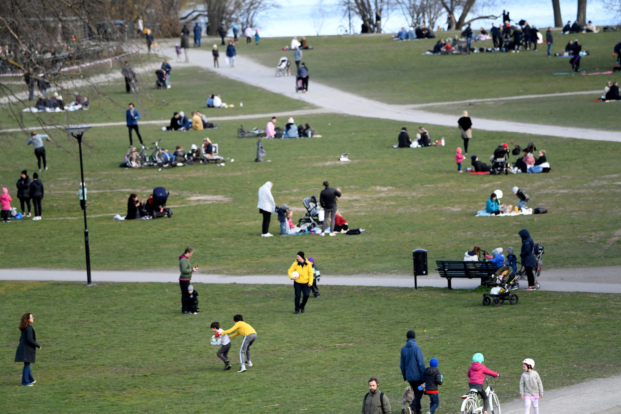 People visit the Raslambshovsparken Park in Stockholm, Sweden, on Saturday April 18, 2020. (AP)