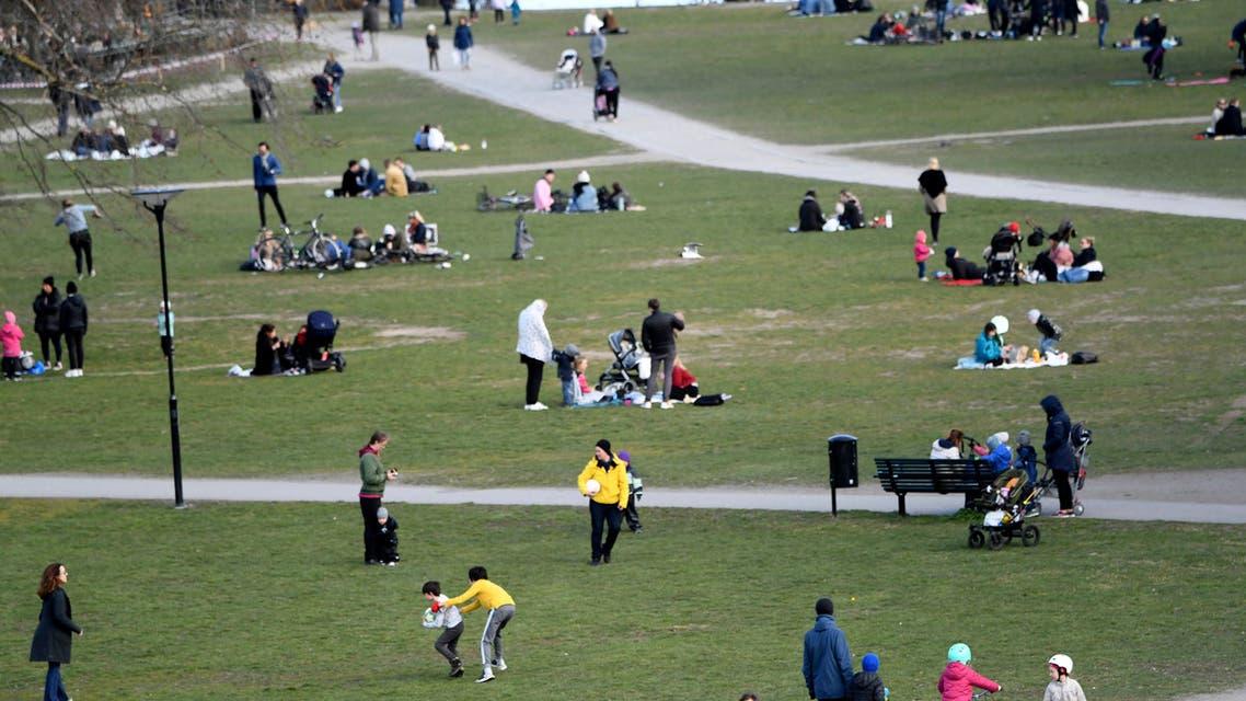 People visit the Raslambshovsparken Park in Stockholm, Sweden, on Saturday April 18, 2020. (AP)