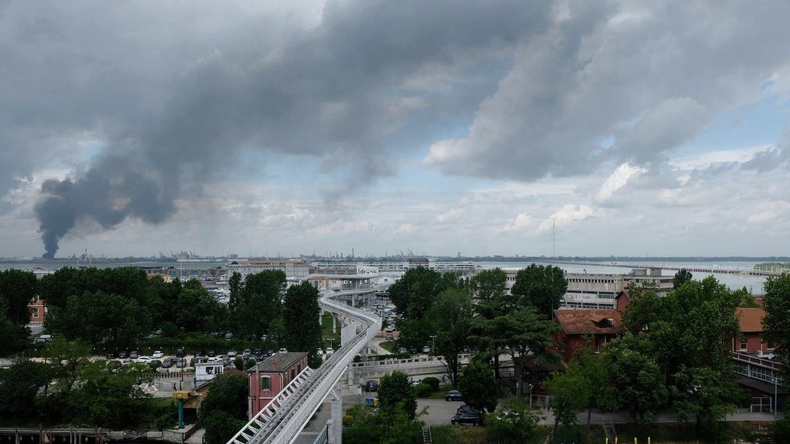 Large clouds of black smoke billows from chemical plant in Marghera near Venice after an explosion, in a view seen from Venice, Italy, May 15, 2020. (Reuters)