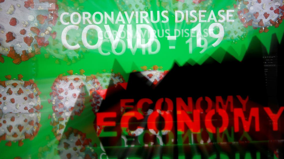A 3D-printed economy stock graph is seen in front of displayed coronavirus disease (COVID-19) words in this illustration taken March 24, 2020. (Reuters)