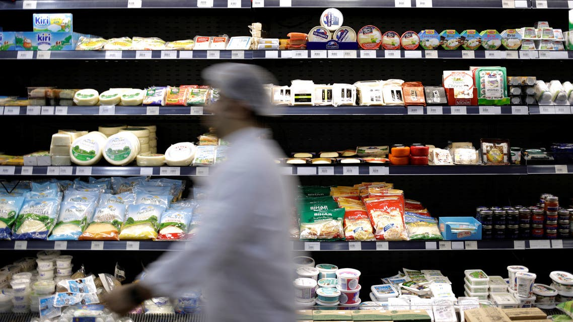 A worker walks past food items displayed for sale inside a supermarket in Beirut, Lebanon November 5, 2019. (Reuters)