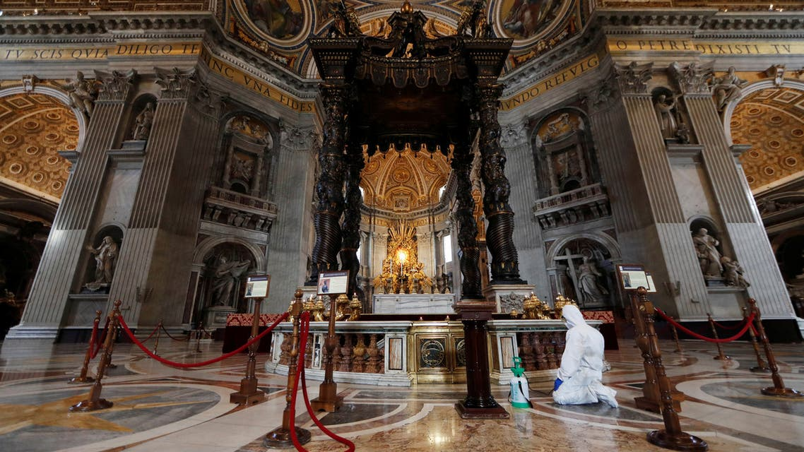 A Vatican staff member in protective gear sanitizes the interior of St. Peter's Basilica, as part of efforts to combat a spread of the coronavirus, at the Vatican, on May 15, 2020. (Reuters)