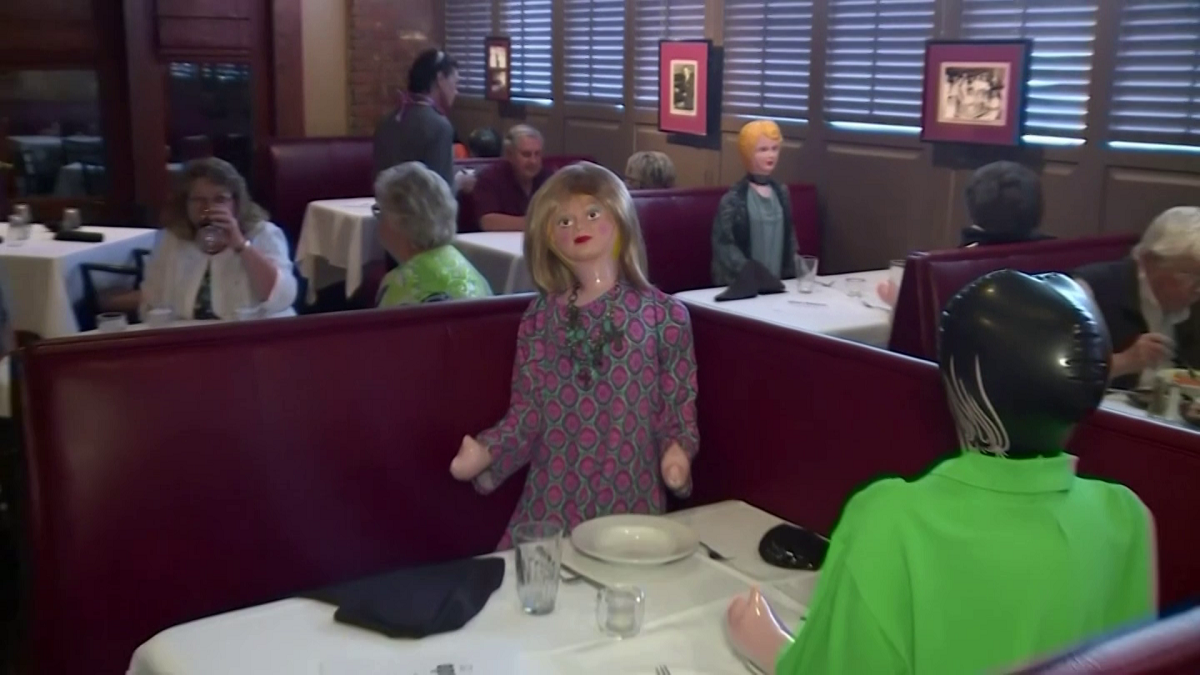 A restaurant in South Carolina uses blow up dolls to maintain social distancing measures. (Screengrab)