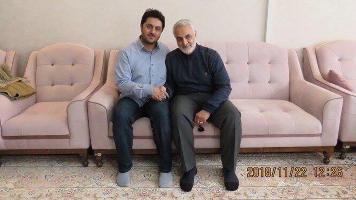 Abolfazl Sarlak pictured with slain IRGC Commander Qassem Soleimani. (KhabarOnline)