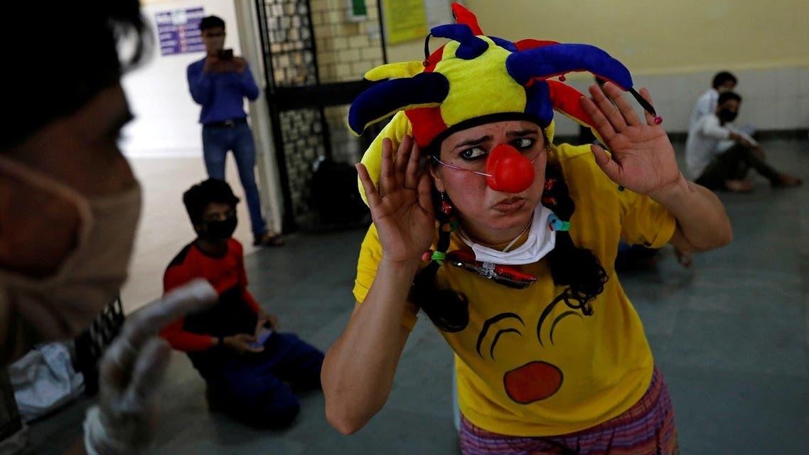 HEALTH-CORONAVIRUS-INDIA-CLOWN- Reuters