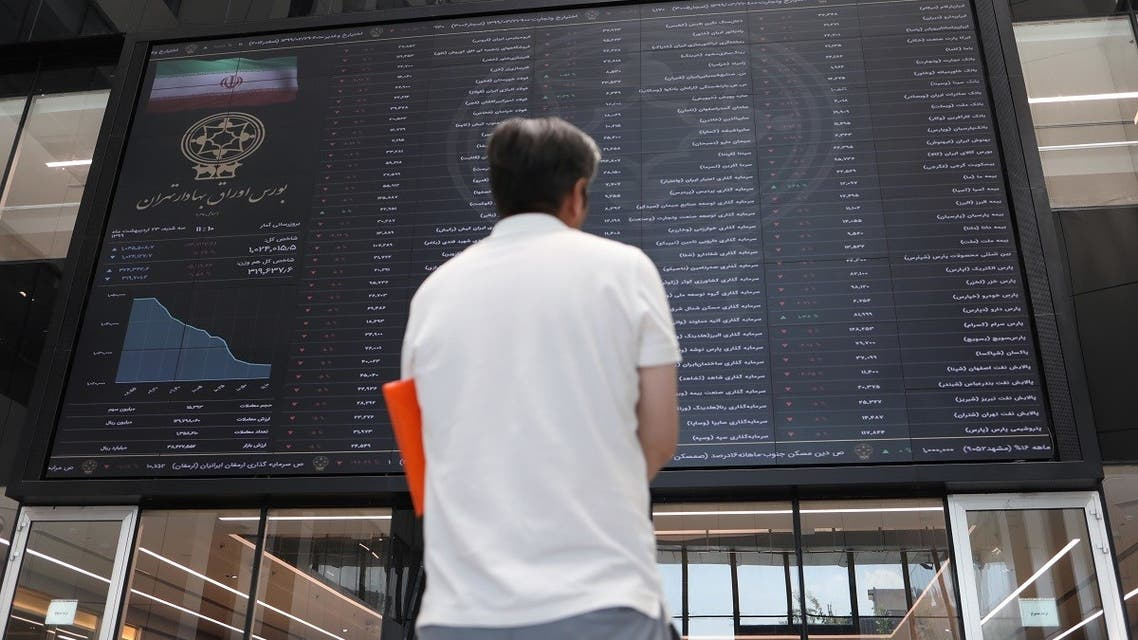 A man looks at electronic board showing stock prices, following the outbreak of the coronavirus disease at Tehran Stock Exchange in Tehran, Iran, May 12, 2020. (Reuters)
