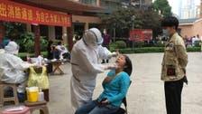 Wuhan residents queue up for mass virus screening, following new corronavirus cases