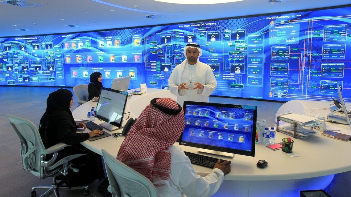 Employees are seen at the Panorama Digital Command Centre at the ADNOC headquarters in Abu Dhabi, UAE, December 10, 2019. (Reuters)