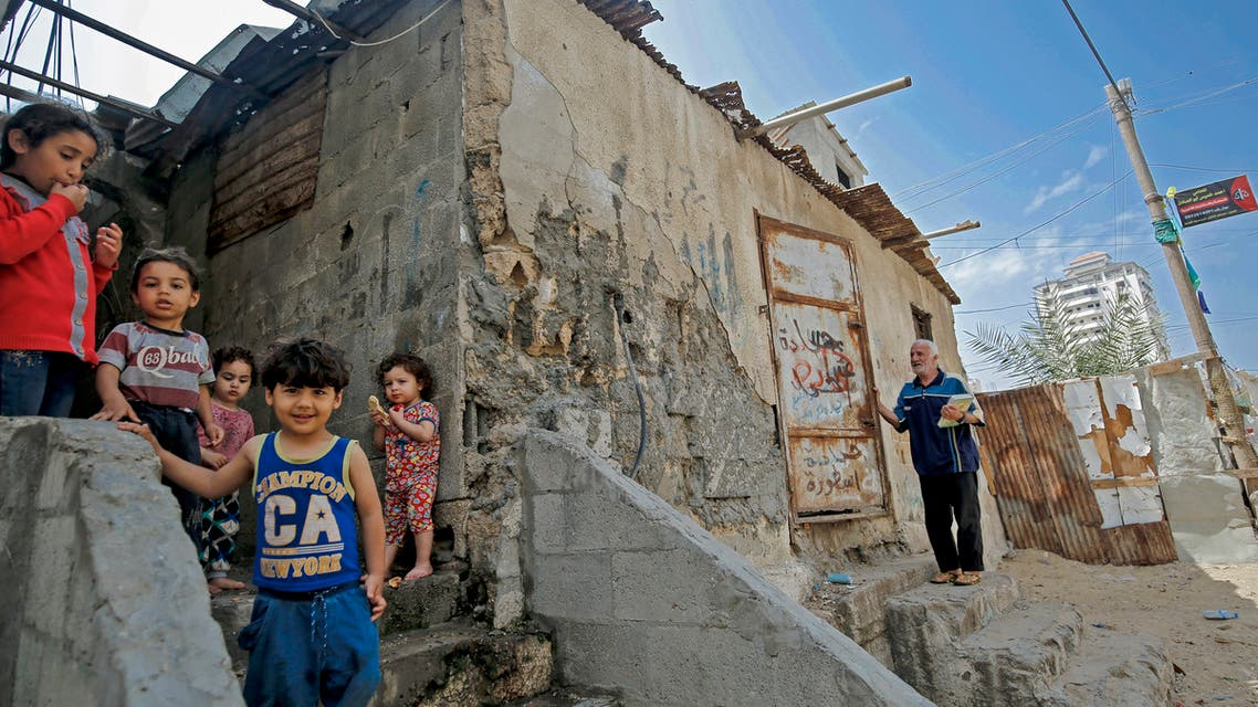 Palestinian children are pictured outside their shacks in Gaza City's Al-Shati refugee camp on May 15, 2020, as Palestinians marked the 72nd anniversary of 'Nakba' (Day of Catastrophe). (AFP)