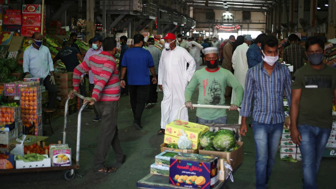 People wear protective face masks following the outbreak of the coronavirus, as they shop at a vegetable market in Manama, Bahrain, April 23, 2020. (Reuters)