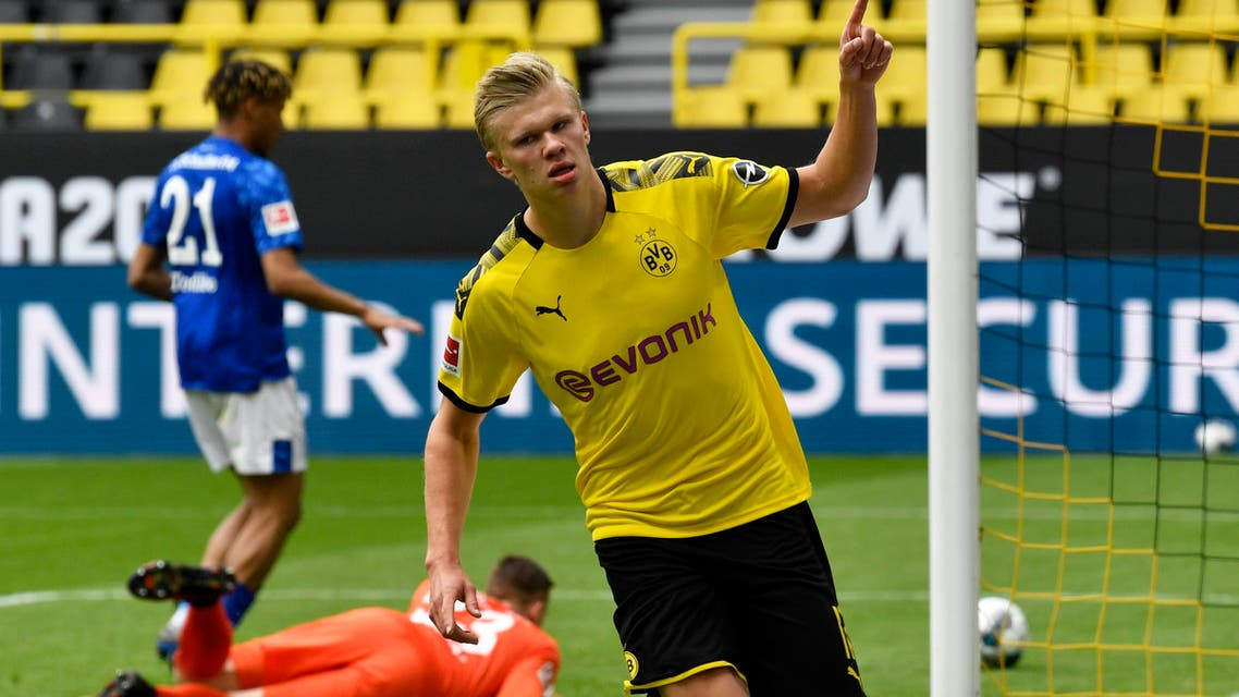 Dortmund's Erling Haaland celebrates after scoring the opening goal during the German Bundesliga soccer match between Borussia Dortmund and Schalke 04 in Dortmund, Germany, on Saturday, May 16, 2020. (AP)