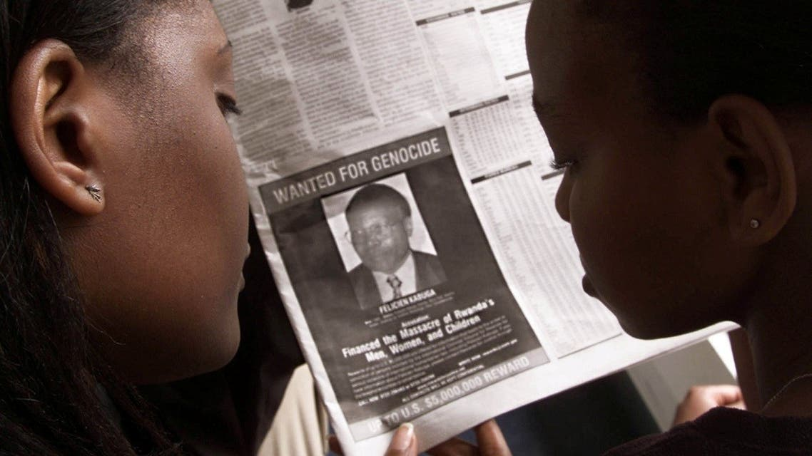 Readers look at a newspaper June 12, 2002 in Nairobi carrying the photograph of Rwandan Felicien Kabuga wanted by the United States. The United States published a wanted photograph in Kenyan newspapers of the businessman accused of helping finance the 1994 killings in Rwanda. (Reuters)
