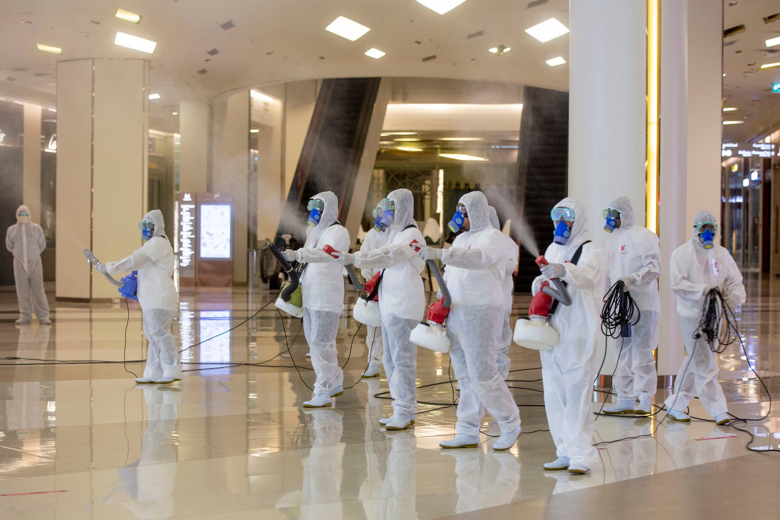 Cleaners in hazmat suits demonstrate disinfection at Siam Paragon, an upmarket shopping mall in Bangkok, Thailand, on Thursday, May 14, 2020. (AP)