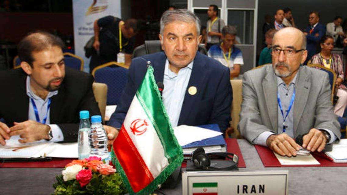 Iran's OPEC governor Hossein Kazempour Ardebili, center, attends OPEC meeting in Algiers, Algeria, September 23, 2018. (AP)