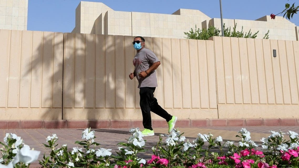 A man wears a protective face mask while jogging, following the outbreak of the coronavirus disease (COVID-19), in Riyadh, Saudi Arabia May 13, 2020. (Reuters)