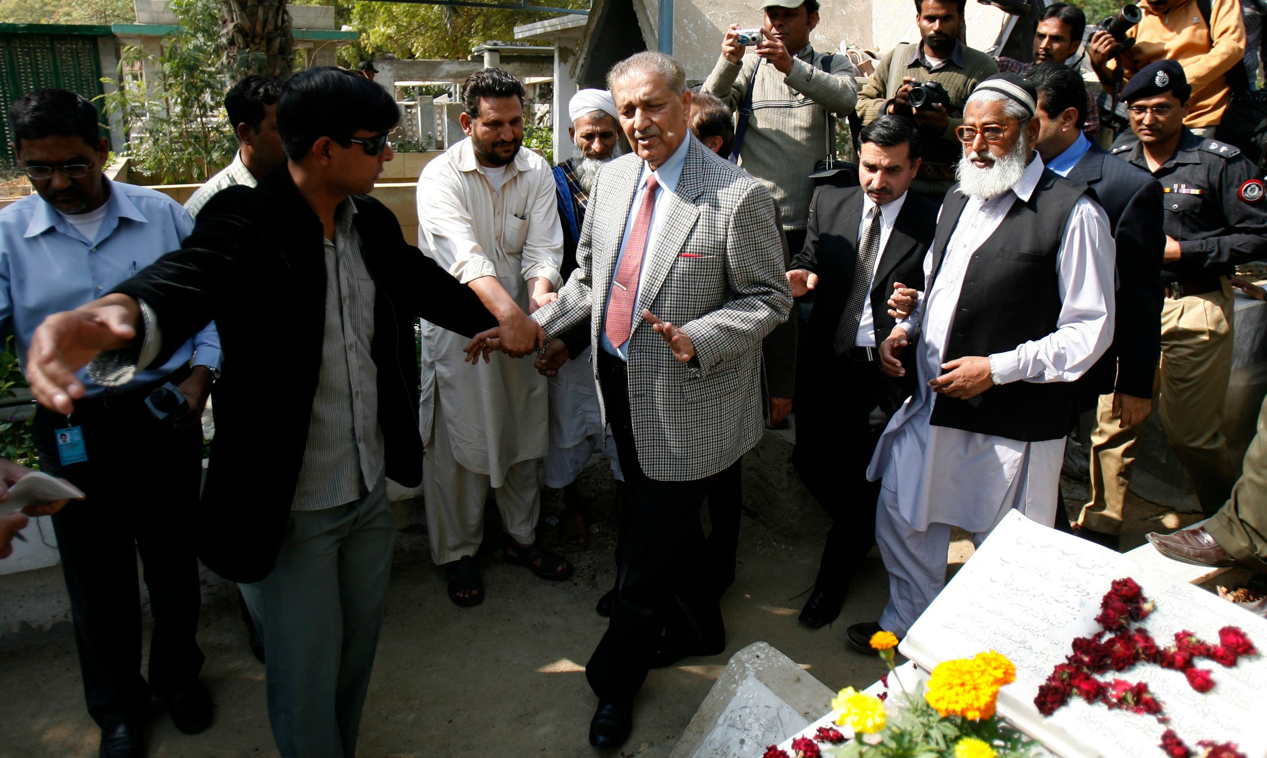 Pakistani nuclear scientist Abdul Qadeer Khan arrives to a graveyard after attending the funeral prayer for his brother, Abdul Qayyum Khan, in Karachi on February 13, 2010. (Reuters)