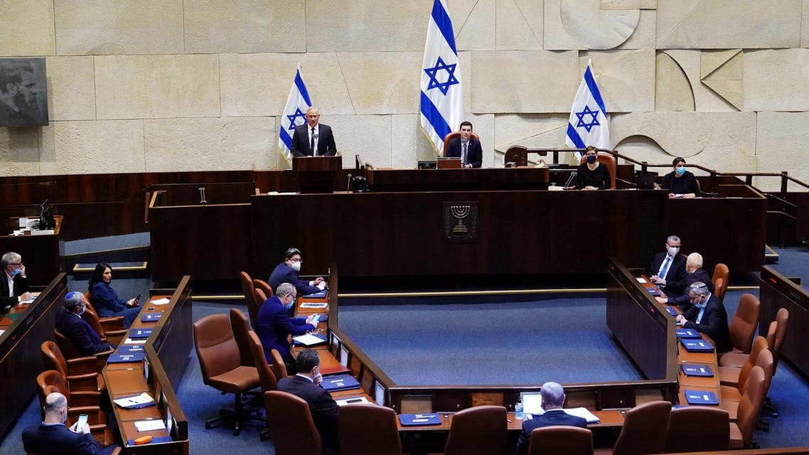 Benny Gantz, centrist Blue and White leader, and Israeli Prime Minister Benjamin Netanyahu's partner in his new unity government, speaks during a swearing in ceremony of the new government, at the Knesset, Israel's parliament, in Jerusalem May 17, 2020. Adina Valman/Knesset spokespersons' office/Handout via REUTERS THIS IMAGE HAS BEEN SUPPLIED BY A THIRD PARTY. MANDATORY CREDIT