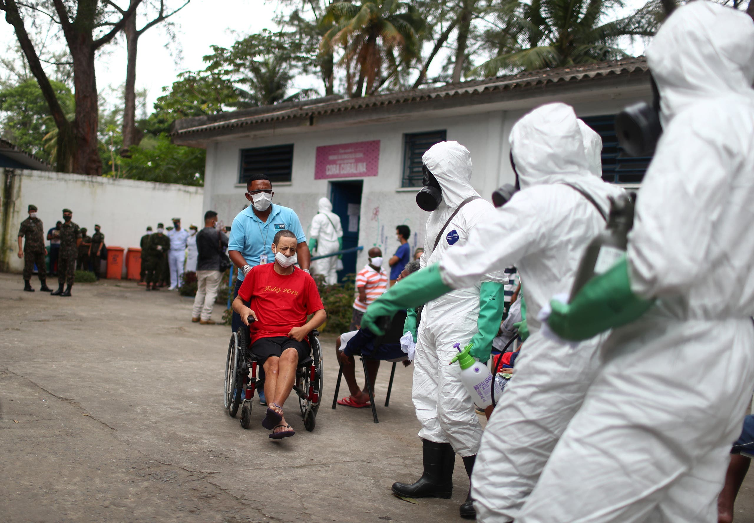 Brazilian army officers disinfect a shelter for elderly people, homeless and patients with mental disorders, amid concerns of the spread of the coronavirus, in Rio de Janeiro, Brazil, May 14, 2020. (Reuters)