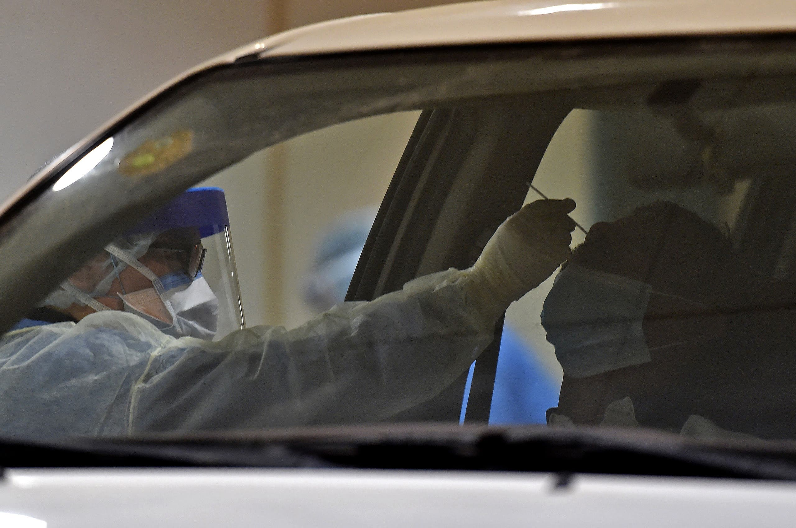 Health workers perform a nose swab test during a drive through coronavirus test campaign held in Diriyah hospital in the Saudi capital Riyadh. (File photo: AFP)