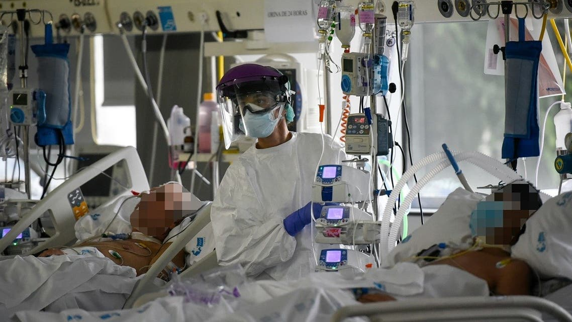 A healthcare worker attends to coronavirus patients at the Intensive Care Unit of the La Paz University Hospital in Madrid on April 23, 2020. (AFP)