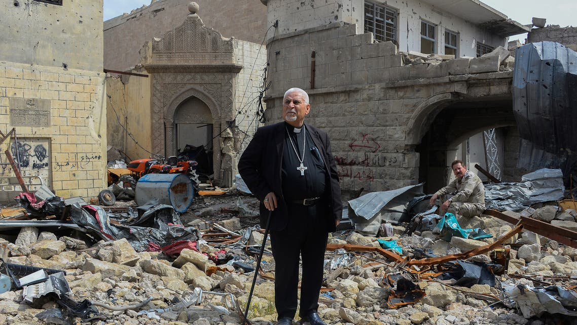 Father John Botros Moshi, the Syriac Catholic Archbishop of Mosul, Kirkuk, and the Kurdistan Region, stands in the rubbles of the Tahra church in Mosul on April 29, 2018. (File photo: AFP)