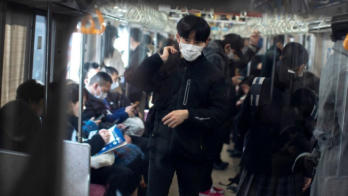 A man wearing a protective face mask travels by train in Tokyo, Japan, February 17, 2020. (Reuters)