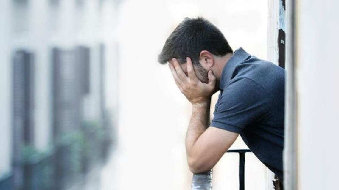 A man holding his head. (File photo: Shutterstock)