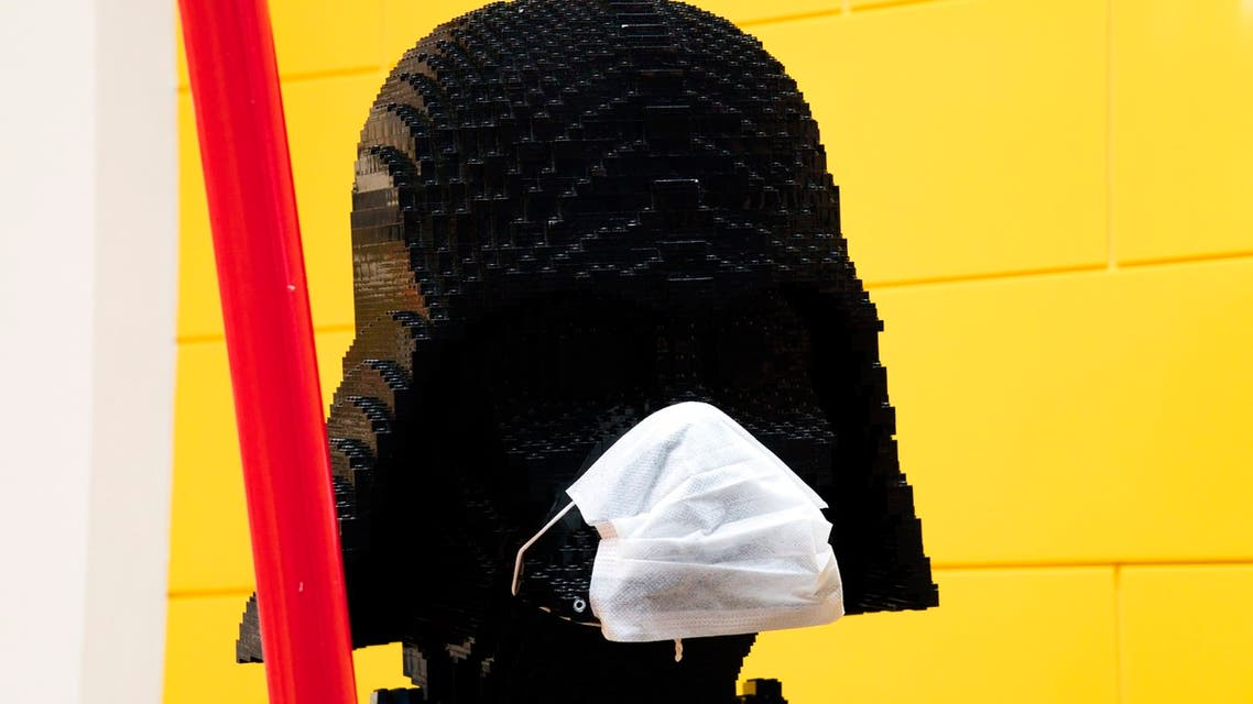 A life-size figurine of the 'Star Wars' villain Darth Vader made entirely of Lego bricks wears a surgical mask amid the coronavirus pandemic at a mall in Dubai, United Arab Emirates, on May 13, 2020. (AP)