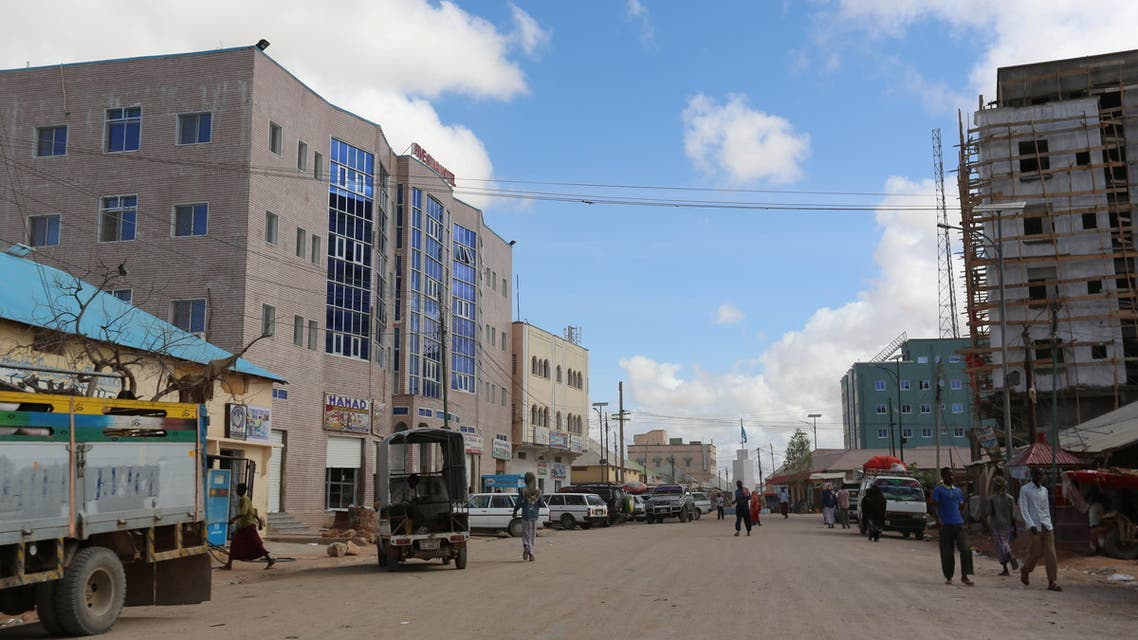 A general view shows people walking along a street in Galkayo, a city divided between the semi-autonomous regions of Puntland and Galmudug, in central Somalia, April 21, 2015. Picture taken April 21, 2015. REUTERS/Feisal Omar