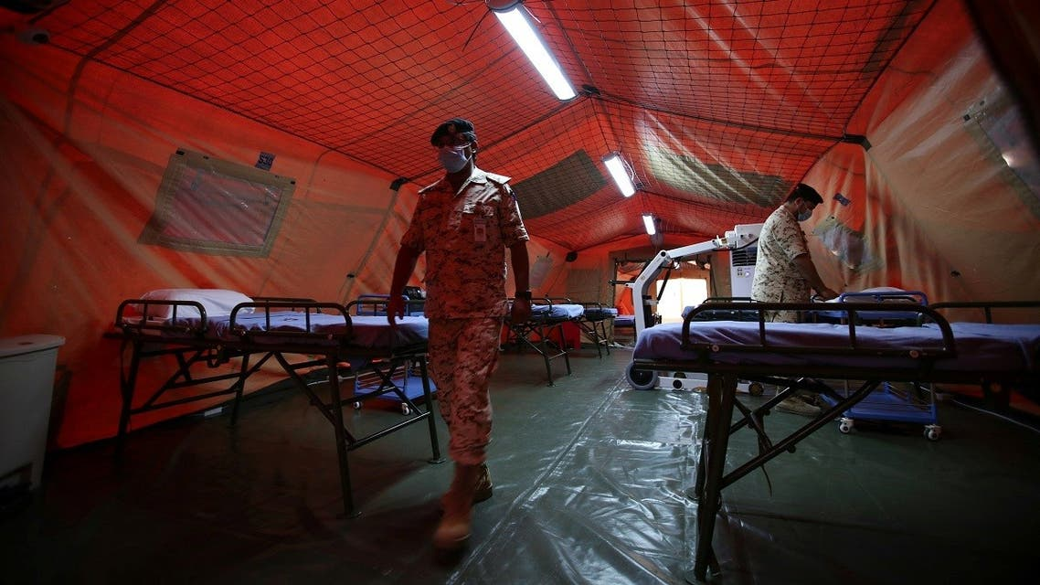 Bahrain Defence Force medical staff wearing protective face masks are seen at a makeshift ICU Field Intensive Care Unit 2 (Sitra) set up by Bahrain authorities to treat the coronavirus disease (COVID-19) critical patients. (Reuters)