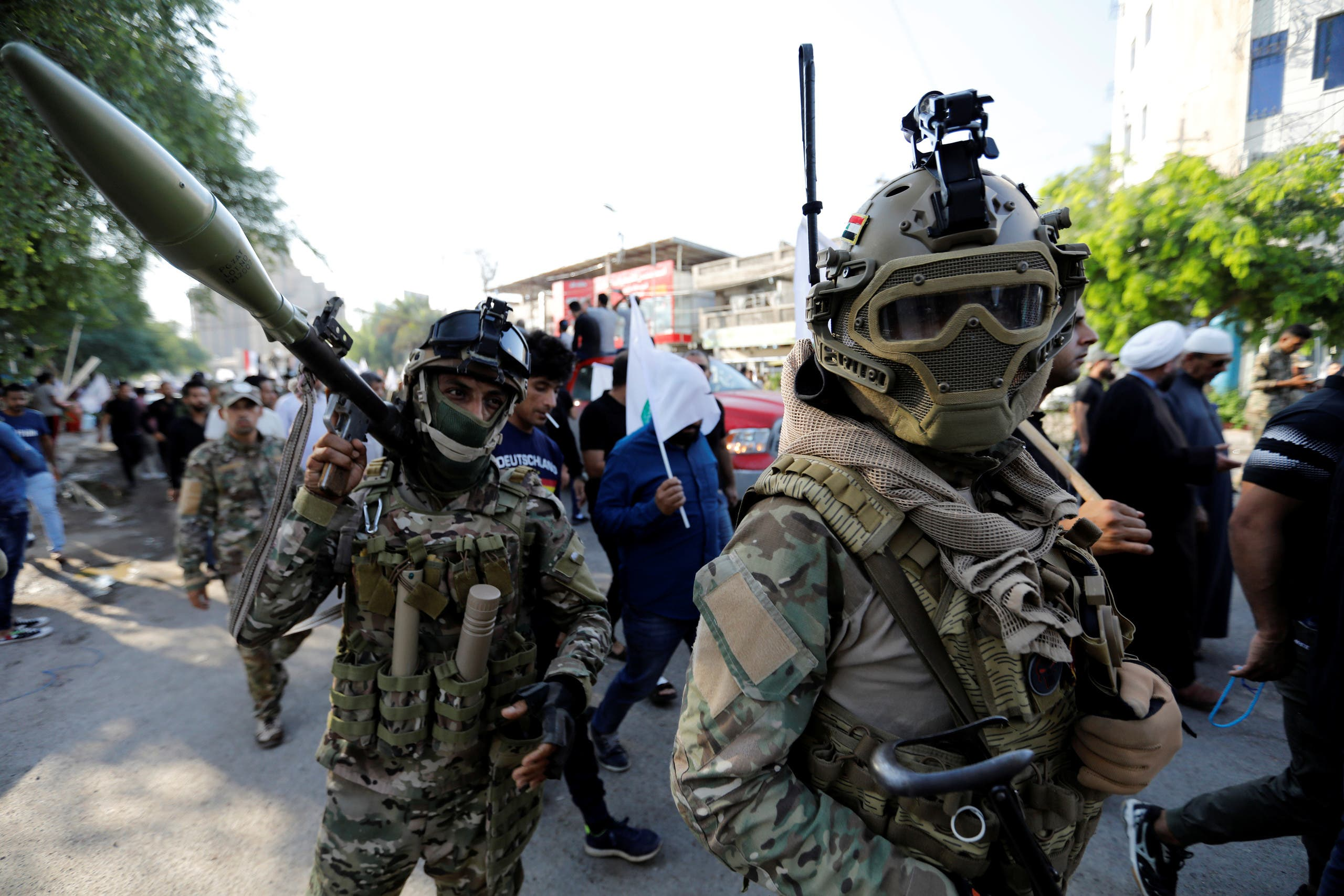 Iraqi Popular Mobilisation Forces (Hashid Shaabi) are seen at a march during the funeral of members of Shi'ite group Asaib Ahl al-Haq, who were killed when protesters attacked the group's office during anti-government protests, in Baghdad, Iraq, on October 26, 2019. (Reuters)