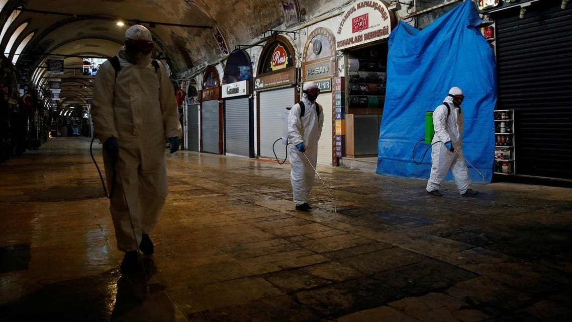 Workers spray disinfectant at Grand Bazaar which will re-open completely on June 1, amid the spread of the coronavirus disease in Istanbul, Turkey, May 8, 2020. (Reuters)