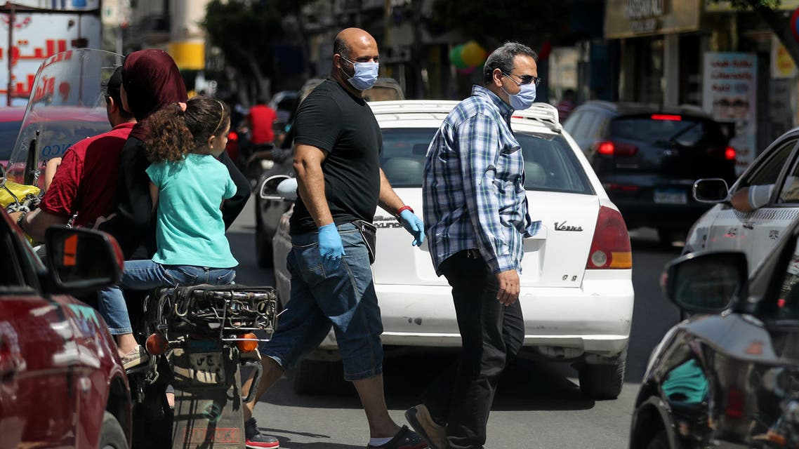 Men wearing protective face masks walk in downtown Cairo, amidst concerns about the spread of the coronavirus disease (COVID-19), Egypt, May 2, 2020. REUTERS/Mohamed Abd El Ghany