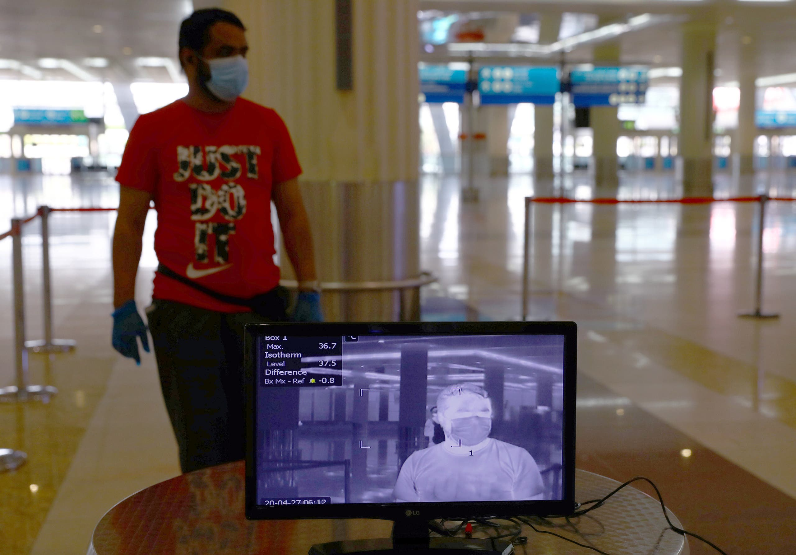 A man is seen through a thermal camera at Dubai International Airport amid the outbreak of the coronavirus disease (COVID-19) in Dubai, UAE April 27, 2020. Picture taken April 27, 2020. (Reuters)
