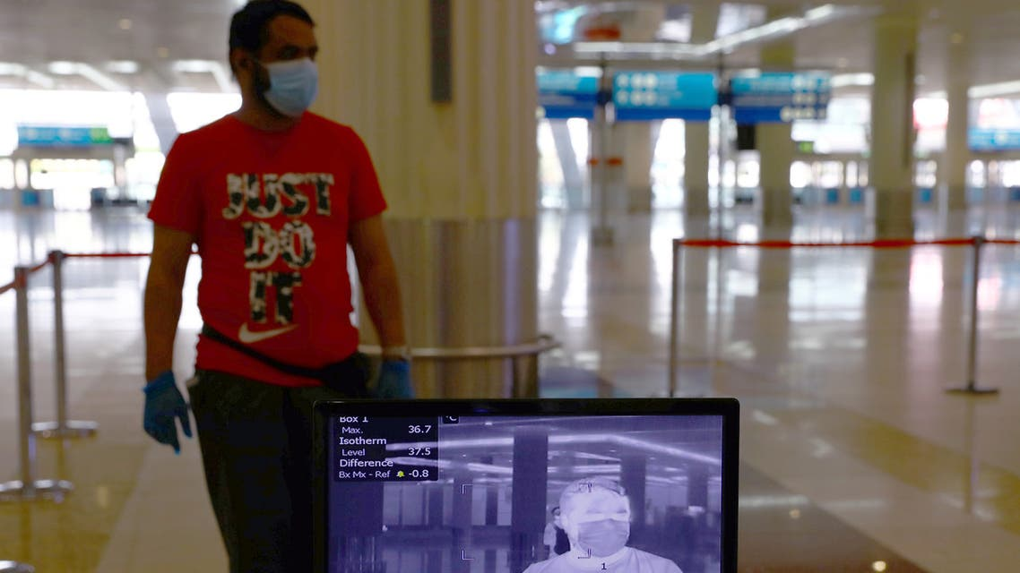 A man is seen through a thermal camera at Dubai International Airport amid the outbreak of the coronavirus disease (COVID-19) in Dubai, UAE April 27, 2020. Picture taken April 27, 2020. REUTERS/Ahmed Jadallah