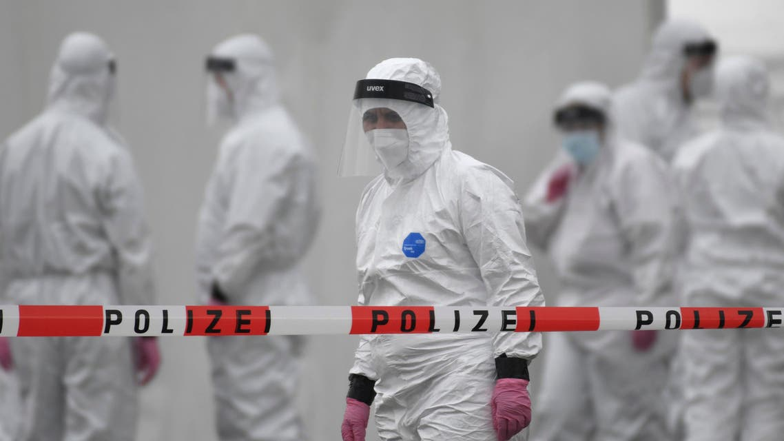 Members of a coronavirus testing station stand on the factory premises of the Westfleisch meat processing company in Hamm, western Germany, on May 10, 2020, as all workers of the company have to be tested on the novel coronavirus after a spike in cases at their slaughterhouse. Local authorities in the western federal state of North Rhine-Westphalia announced on May 8, 2020 that reopening plans were postponed and an emergency mechanism would come into effect due to high infection rates in the region. Many of the Westfleisch company's workers, partially originating from Eastern Europe and housed in shared accomodation, were tested positive on the novel coronavirus that can cause the COVID-19 disease.