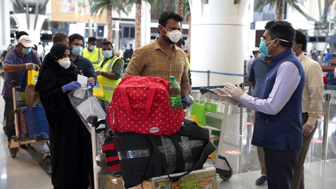 Indian nationals check in at the Muscat International Airport before leaving the Omani capital on a flight to return to their country, on May 9, 2020. (AFP)