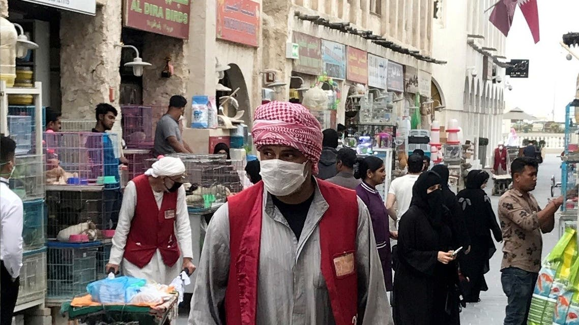 A man wears a protective face mask, following the outbreak of coronavirus, as he pushes a cart in souq Waqif in Doha. (File photo: Reuters)  2