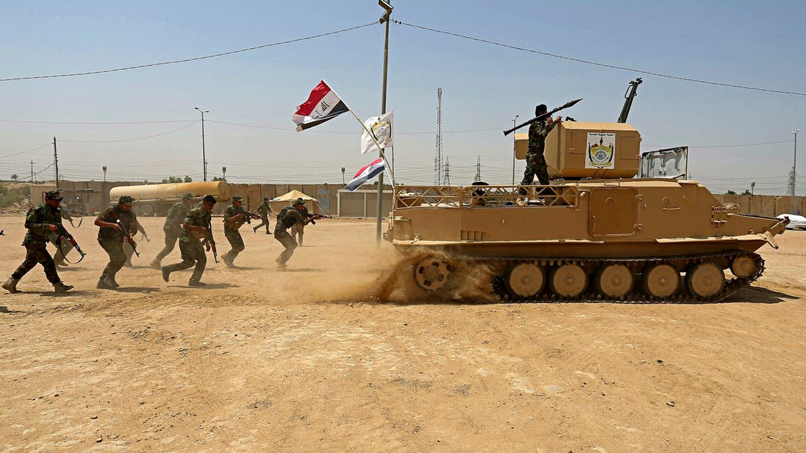 Shia volunteer fighters from the Imam Ali Brigade, an armed faction with the Iraqi Popular Mobilization Forces, train at their camp, in Najaf, south of Baghdad, Iraq on July 18, 2017. (File photo: AP)