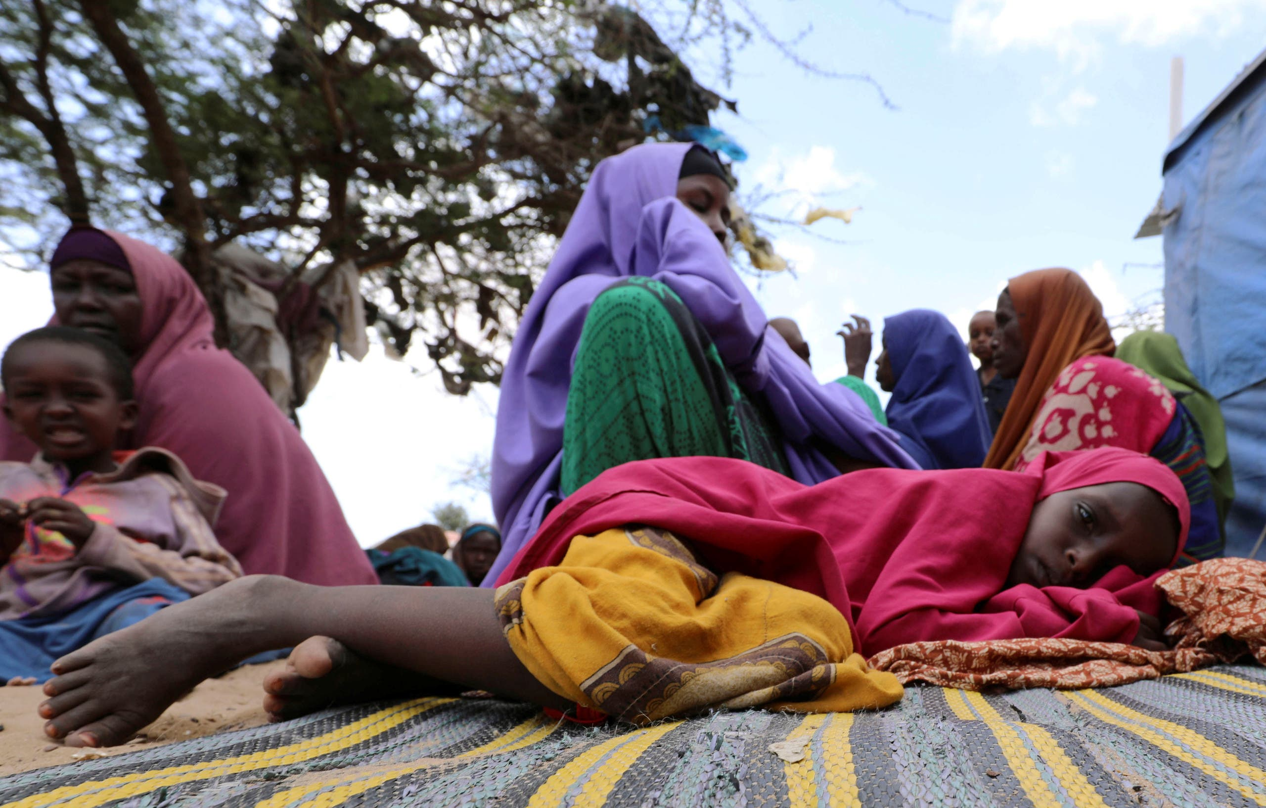 A Somali girl rests at an IDP (internally displaced person) camp near Mogadishu, Somalia on March 12, 2020. (Reuters)