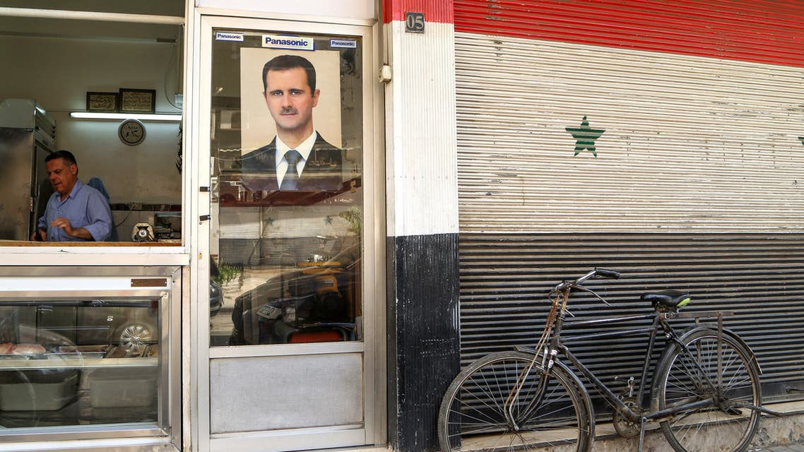 A picture of Syrian President Bashar al-Assad in Damascus, Syria April 22, 2020. (Reuters)