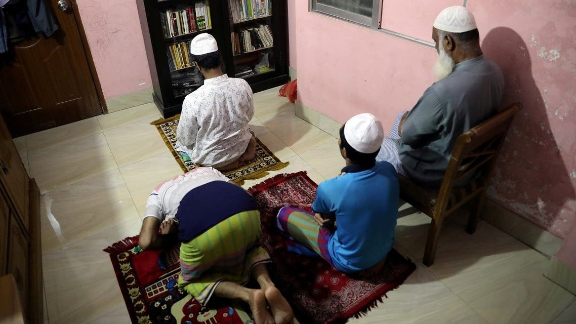 Muslims perform evening prayer in their home during Ramadan as mosques are closed amid concerns over the coronavirus disease (COVID-19) outbreak in Dhaka. (Reuters)