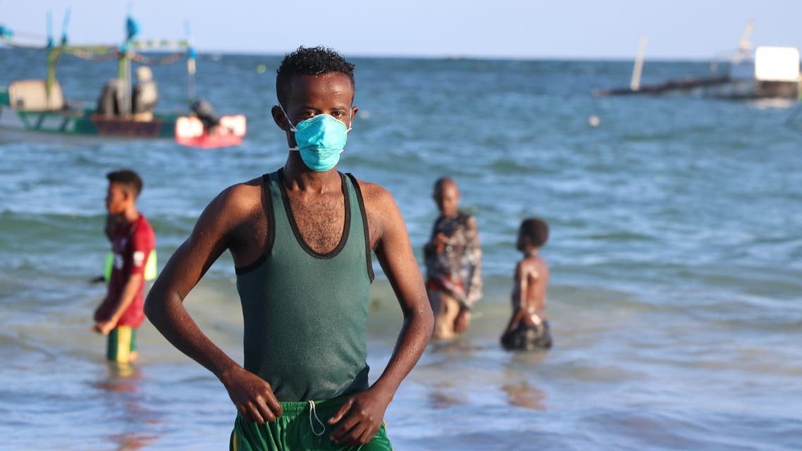 A man wears a mask as a protective measure to curb the Covid-19 coronavirus while bathing at Lido beach in Mogadishu, Somalia, on April 4, 2020. (AFP)