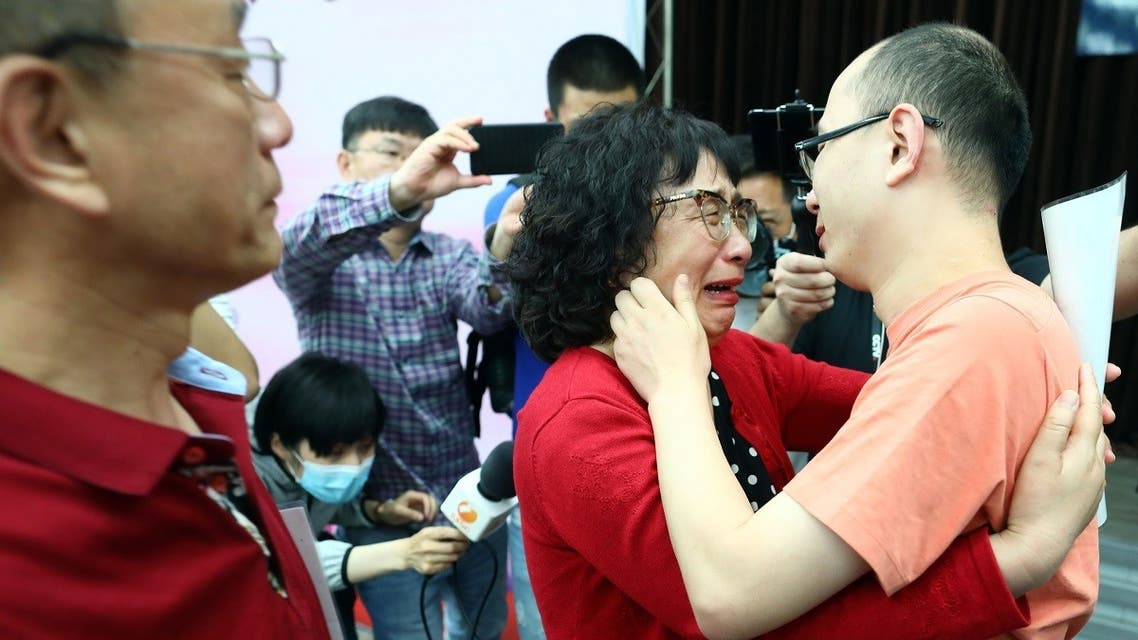 This photo taken on May 18, 2020 shows Mao Yin (R) with his mother Li Jingzhi after they were reunited in Xian, in China's northern Shaanxi province. (AFP)